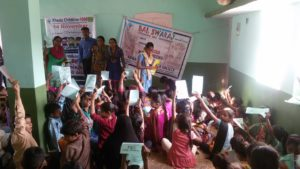 Arranged compitition with children at matar