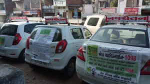 Attached child line  posters behind cars